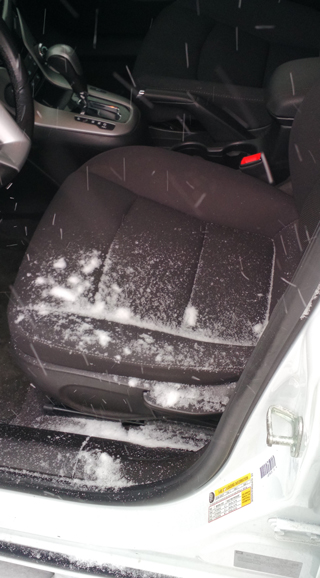 Falling snow inside the car