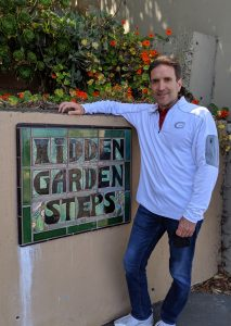 Gregg Borodaty at the Hidden Garden Steps Sign in San Francisco