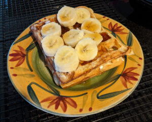 Sourdough waffles with bananas and maple syrup